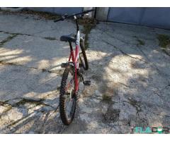 Bicicleta Alpha Mission aproape noua
